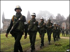 Cambodian military police officers patrol past a famed temple of Preah Vihear, Aug 2008
