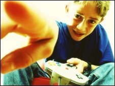 Boy playing computer game, BBC/Corbis