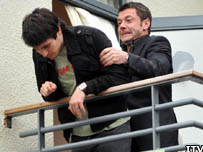 Tony Gordon pushing Liam Connor off a balcony