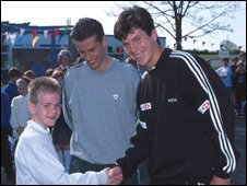 Tennis fan Oliver Hewitt with Richard Bacon and Tim Henman