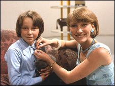 Lesley Judd gives a Blue Peter badge to a viewer