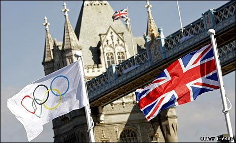 The Olympic flag and Union Jack fly beside Tower Bridge in London