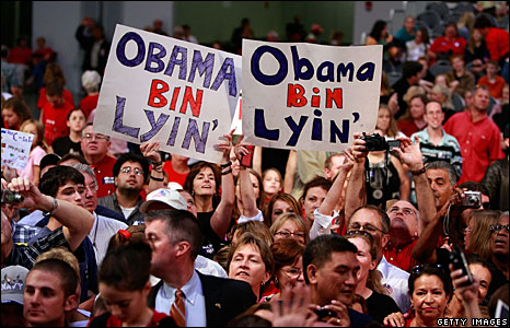 """Attendees at a McCain campaign rally in Virginia Beach, Virginia, hold up signs saying """"Obama Bin Lyin'"""""""