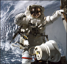 An astronaut taking a spacewalk outside of the space shuttle Discovery