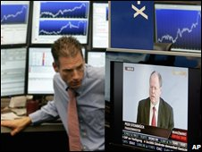 A broker watches as German finance minister Peer Steinbrueck is seen on TV at the stock market in Frankfurt
