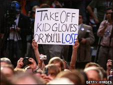 A supporter holds a sign at a McCain-Palin rally, Virginia, 13 Oct