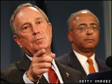 William Thompson stands to the right of Mayor Michael Bloomberg