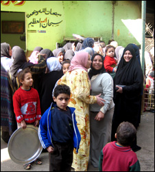 A family in the bread queue in Cairo, Egypt