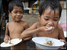 Filipino children eating rice