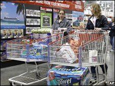 Shoppers leave a Costco store in Chicago (Oct. 8)