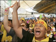 Anti-government protesters cheer outside Government House in Bangkok, Oct 2008