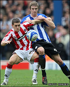 Sheffield United's Billy Sharp and Sheffield Wednesday's Mark Beevers