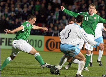 David Healy (left) scores