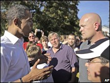 Barack Obama speaks to plumber Joe Wurzelbacher in Holland,Ohio on 12/10/2008