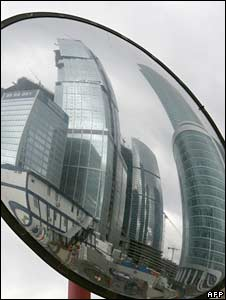 Modern buildings are reflected in a traffic safety mirror in Moscow. Photo: October 2008