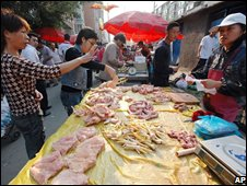 Chinese shoppers at a market