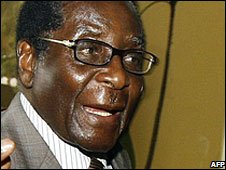 Robert Mugabe arrives for the talks in Harare on 14 October