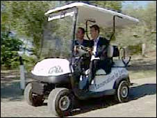 Duncan Kennedy (left) and Lorenzo Fasola Bologna on a golf cart