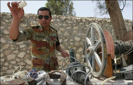 An Egyptian security officer shows off seized tunnel-building equipment