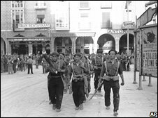 Fascist volunteers march though Burgos, northern Spain, in 1936 