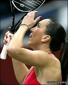 Jelena Jankovic holds her head in her hands after losing a point against Flavia Pennetta