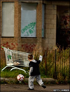 Boy playing football in Govan, Glasgow
