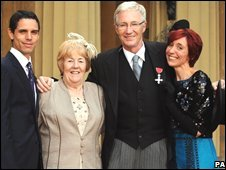Paul O'Grady with his partner (l), sister and daughter