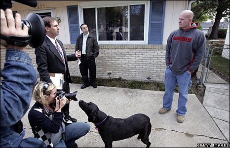 Joe Wurzelbacher, AKA Joe the plumber, talks to the media outisde his home in Holland, Ohio.