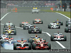 Lewis Hamilton locks his wheels trying to pass Kimi Raikkonen at the start of the Japanese Grand Prix