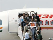 Indian Civil Aviation Minister Praful Patel (C) together with other officials participate in the induction ceremony of an Air India Airbus A319 aircraft during the opening day of India Aviation 2008 at Begumpet Airport in Hyderabad on October 15, 2008.