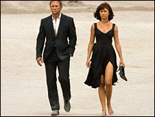 Daniel Craig as James Bond and Olga Kurylenko as Camille