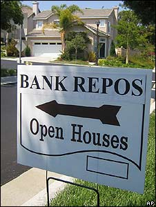A sign advertises a bank repossessed home for sale (file photo)