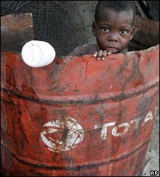 Nigerian boy in an oil drum