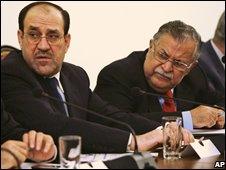 Iraqi Prime Minister Nouri Maliki (l) and President Jalal Talabani (17 Oct)