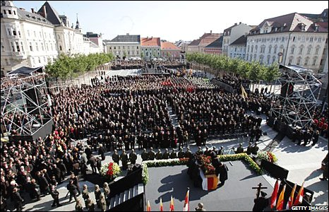 The coffin of Joerg Haider is covered with roses at his funeral service in Klagenfurt, Austria