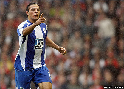 Zaki celebrates scoring his second for Wigan