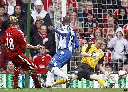 Liverpool's Dirk Kuyt scores