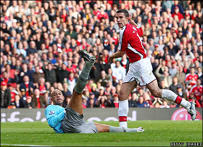 Arsenal's Robin van Persie scores the second