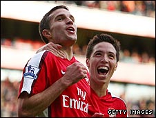 Robin van Persie is congratulated by Samir Nasri