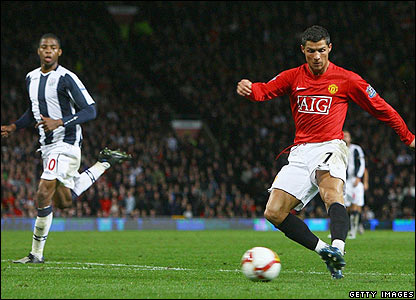 Ronaldo slots the ball past West Brom keeper Scott Carson