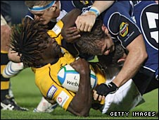 Wasps' England winger Paul Sackey is hammered to the ground by Cian Healey