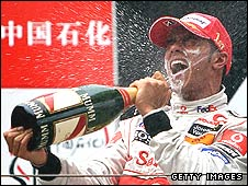 Lewis Hamilton celebrates victory in the Chinese Grand Prix, which puts him on the verge of the world title