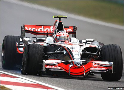 Heikki Kovalainen suffers a punctured tyre in China
