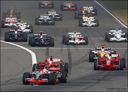 Lewis Hamilton's McLaren leads the Ferraris of Kmi Raikkonen and Felipe Massa at the start of the Chinese Grand Prix