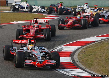 Lewis Hamilton leads Kimi Raikkonen, Felipe Massa, Heikki Kovalainen, Fernando Alonso and Nick Heidfeld at the second corner of the Chinese Grand Prix