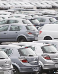 Cars await collection from the Vehicle Distribution Centre at the Vauxhall manufacturing plant in Ellesmere Port, north-west England