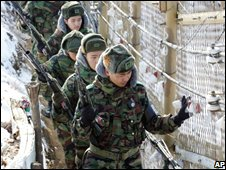 South Korean soldiers walk along the DMZ perimeter