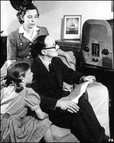 Family listening to radio announcement, PA