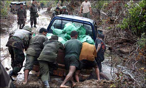 Sri Lanka soldiers push vehicle stuck in mud south of Kilinochchi <i>(Photo: Ministry of Defence)</i>