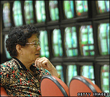 Investor watching screens showing share prices (Getty Images)